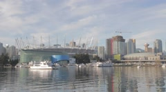 Pan BC place downtown Vancouver - sunshine Stock Footage
