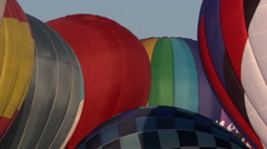 Domes of hot air balloons on sky background - stock footage