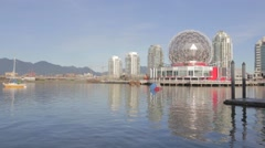 Great sunny day - Science world, mountains and skytrain Stock Footage