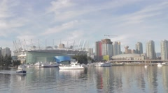 Aqua bus approaching - background BC place and downtown Vancouver Stock Footage