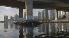 Under the Cambie bridge to Yaletown marinaside condos Stock Footage