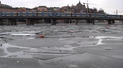 1m Tunnelbana Trains and Traffic Across Icy River Stockholm Stock Footage