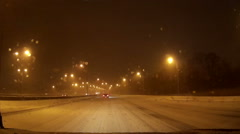 POV driving at night in snow storm on cold winter night - stock footage