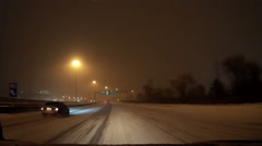Stock Video Footage of POV driving at night in snow storm on cold winter night