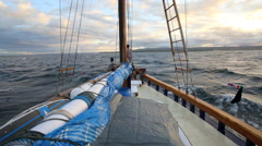 Traditional wooden yacht cruising through ocean Stock Footage