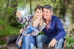 Happy Couple Taking Selfportrait At Campsite - stock photo