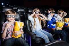 Scared Children Watching 3D Movie In Cinema Theater Kuvituskuvat