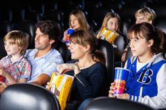 Families Watching Movie In Cinema Theater Kuvituskuvat