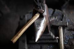 Anvil and hammer - stock photo