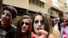 Zombie walk festival, young zombies walking on street Stock Footage