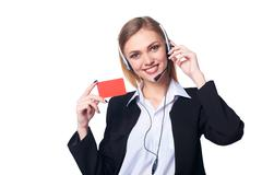 Friendly female helpline operator - stock photo
