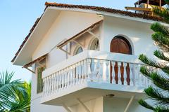 White house with a balcony in a tropical climate Stock Photos
