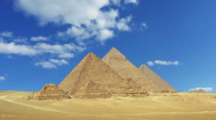 Clouds over great pyramids in Egypt - zoom in timelapse Stock Footage