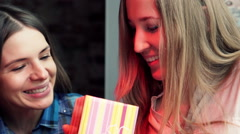 Woman gets gift from her girlfriend in cafe  HD - stock footage