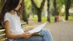 Female student studying in the park Stock Footage