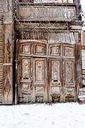 Old decayed wooden door. Single Wooden Door in Old City Wall - stock photo