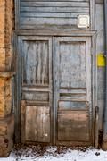 Two Wooden Doors in Old City Wall. Old decayed wooden door Stock Photos