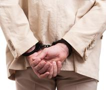 Arrested man handcuffed hands at the back Stock Photos