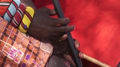 Samburu tribesman playing traditional wind instrument. Stock Footage