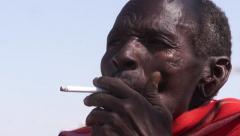 Samburu tribesman smokes. Stock Footage