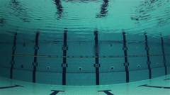 Empty Olympic Swimming Pool Underwater with lanes and ripples on the surface Stock Footage