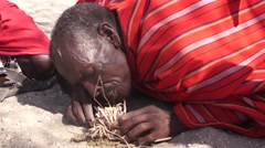 Samburu tribesman making fire in traditional way. Stock Footage