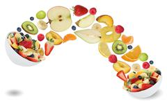 Stock Photo of Healthy eating fruit salad with fruits like apples, oranges, kiwi, peach, ban