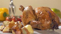 roast chicken with baked potatoes on white plate rotating - stock footage