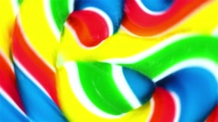 Close view of a vibrant lollipop spinning in circles - stock footage