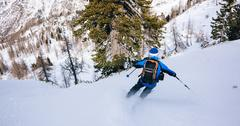Stock Photo of Winter sport: man skiing in powder snow.