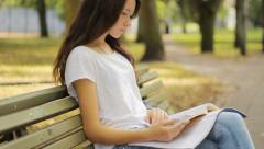 Student studying in the park Stock Footage