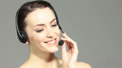 Stock Video Footage of Woman using an office headset