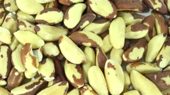 Portion of Brazil Nuts (seamless loopable) Stock Footage