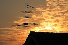 Old television antenna (Fishbone)  against sunrise - stock photo