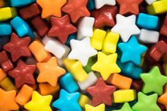 Multicolored stars candies closeup Stock Photos