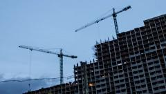 Crane construction Of Building. Time Lapse. day to night Stock Footage