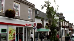 Scotland city of Invergordon 008 grocery store in the main street Stock Footage