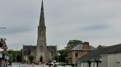 Scotland city of Invergordon 007 church with tall bell tower Stock Footage