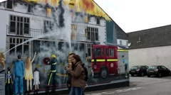 Scotland city of Invergordon 005 burning house as a painted motif on a facade - stock footage