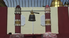 Stock Video Footage of Pathein, large gong between wooden posts