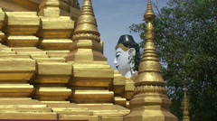 Pathein, Big Buddha statue behind a Pagoda Stock Footage