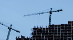 Crane construction Of Building. Time Lapse. close up day to night Stock Footage