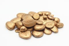 Gold Pebble contemplkation of richness - stock photo