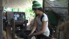 Pathein, Woman making rope from coconut fiber - stock footage