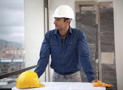 Hispanic man in hard-hat on construction site Stock Photos