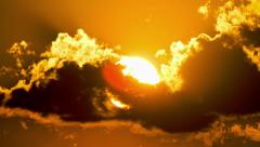 Sunset close up sun disc beautiful fiery golden clouds,rays and beams Stock Footage