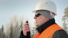 Forest inspector talking on a walkie-talkie in the woods - stock footage