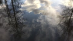 Dreamy reflection of trees and clouds in water Stock Footage