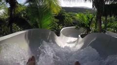 Waterslide at vacation resort aqua park having fun and playing Stock Footage