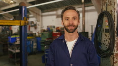 Mechanic listening and nodding while having a video call Stock Footage